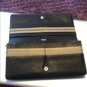 Tumi black and beige leather wallet.